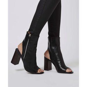 Heeled peep toe boots